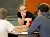 Knowledge Bowl students discuss answer during 2014 competition.
