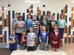 Chess tournament participants with their medals.