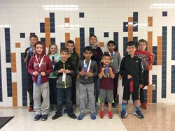 Group of chess students with ribbons.